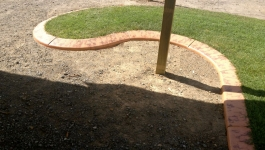 Concrete garden edging can curve around obstacles